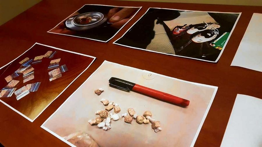 "Authorities displayed photos of what heroin, opioids and other drug paraphernalia might look like at a ""Heroin Highway"" forum at the Gail Borden Public Library in Elgin."