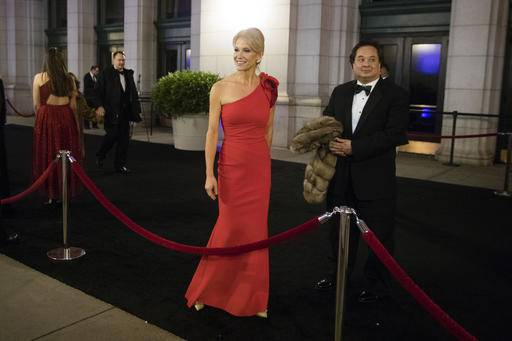 Kellyanne Conway, center, accompanied by her husband, George, speaks with members of the media as they arrive for a dinner at Union Station in Washington, the day before Trump's inauguration.