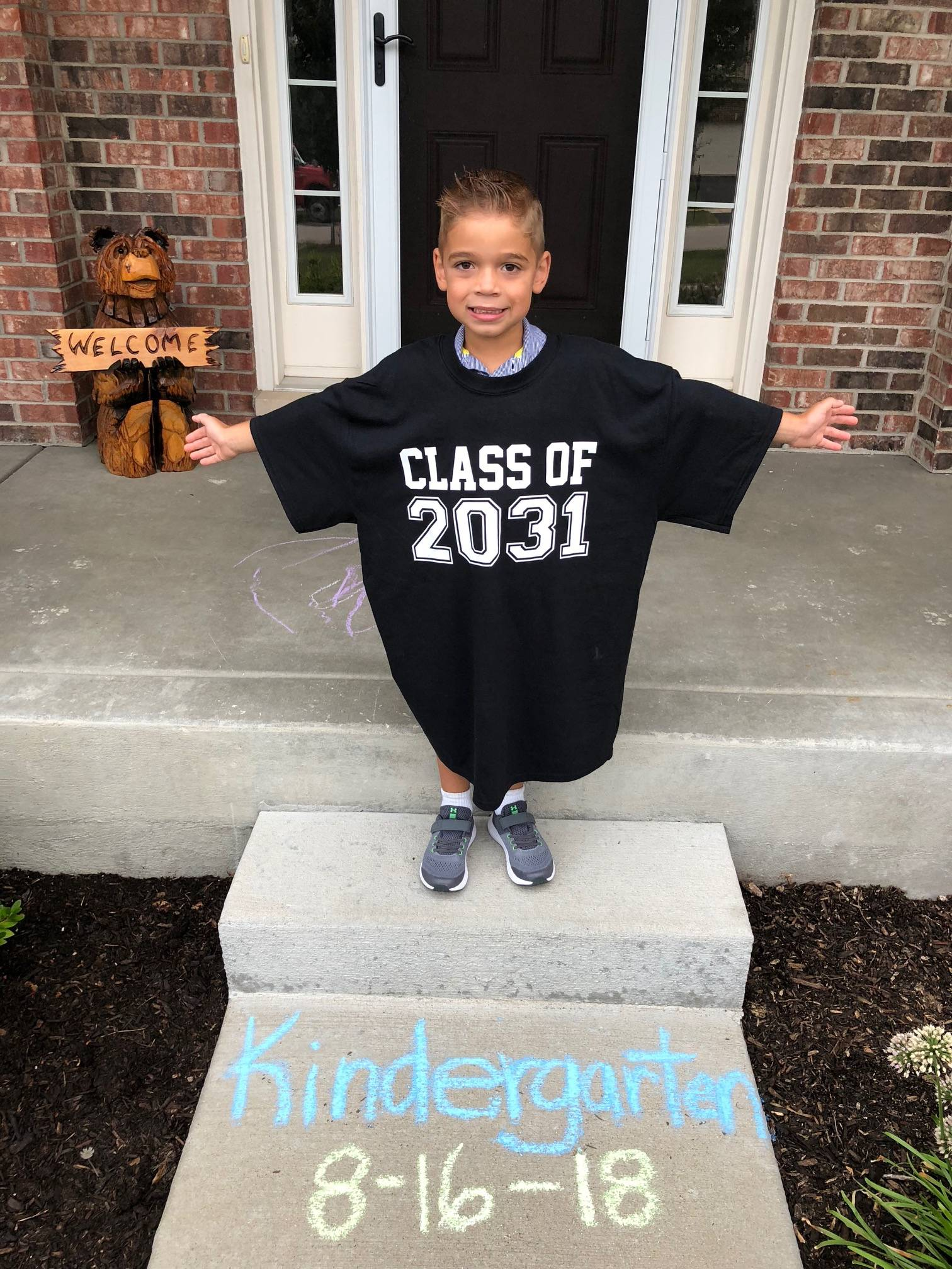 Andrew Kravcar on his first day of kindergarten at Fearn Elementary School, Aurora. His mother, Jamie Kravcar, bought him this shirt and we will watch Andrew grow into it through the years. Clever concept.