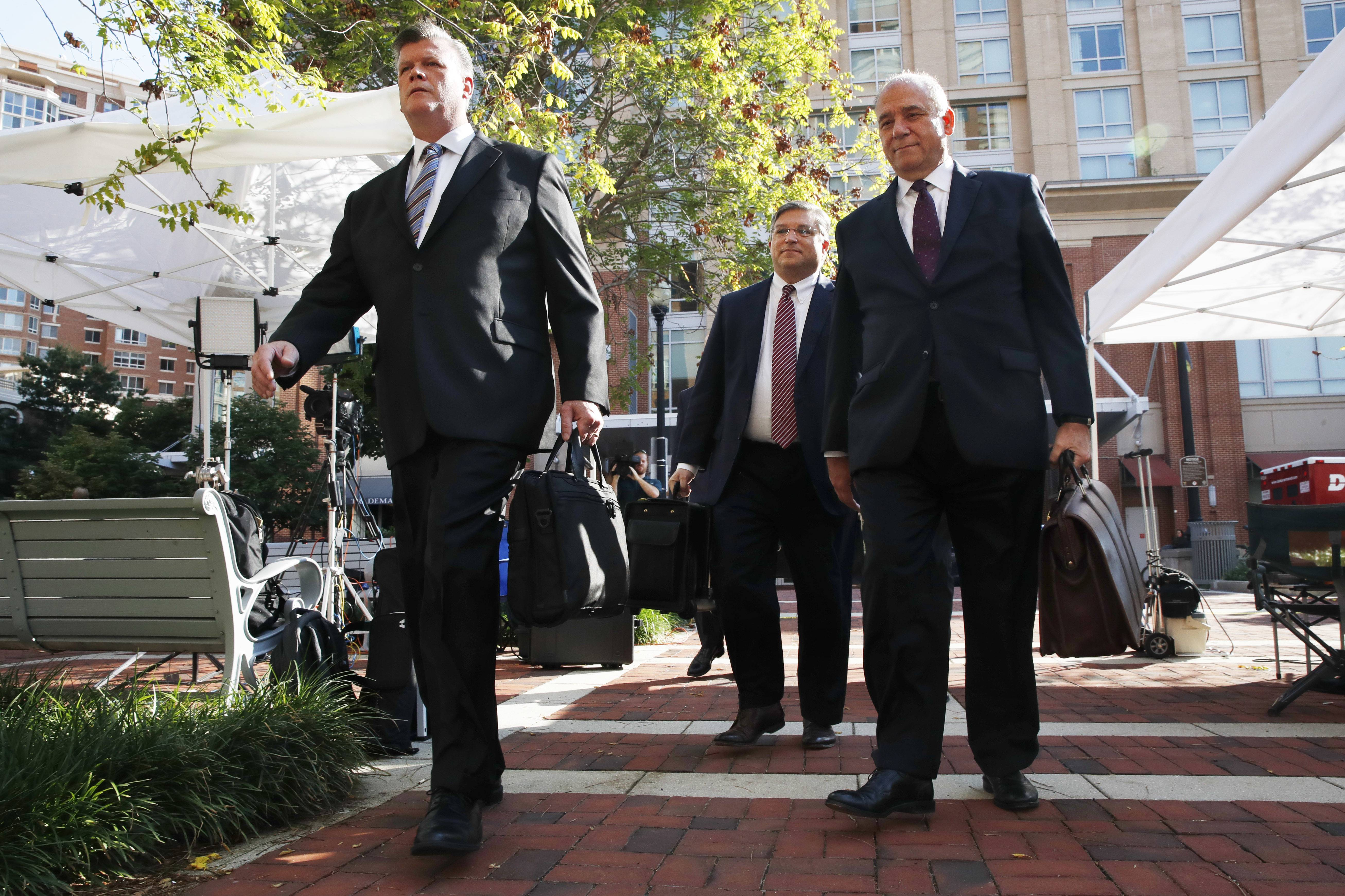 Members of the defense team for Paul Manafort, from left, Kevin Downing, Richard Westling, and Thomas Zehnle, walk to federal court for closing arguments in the trial of the former Trump campaign chairman, in Alexandria, Va., Wednesday, Aug. 15, 2018. (AP Photo/Jacquelyn Martin)