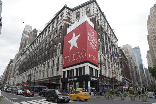 FILE- In this May 16, 2018, file photo, traffic makes it's way past the Macy's flagship store in New York. Macy's Inc. reports earnings Wednesday, Aug. 15. (AP Photo/Mary Altaffer, File)