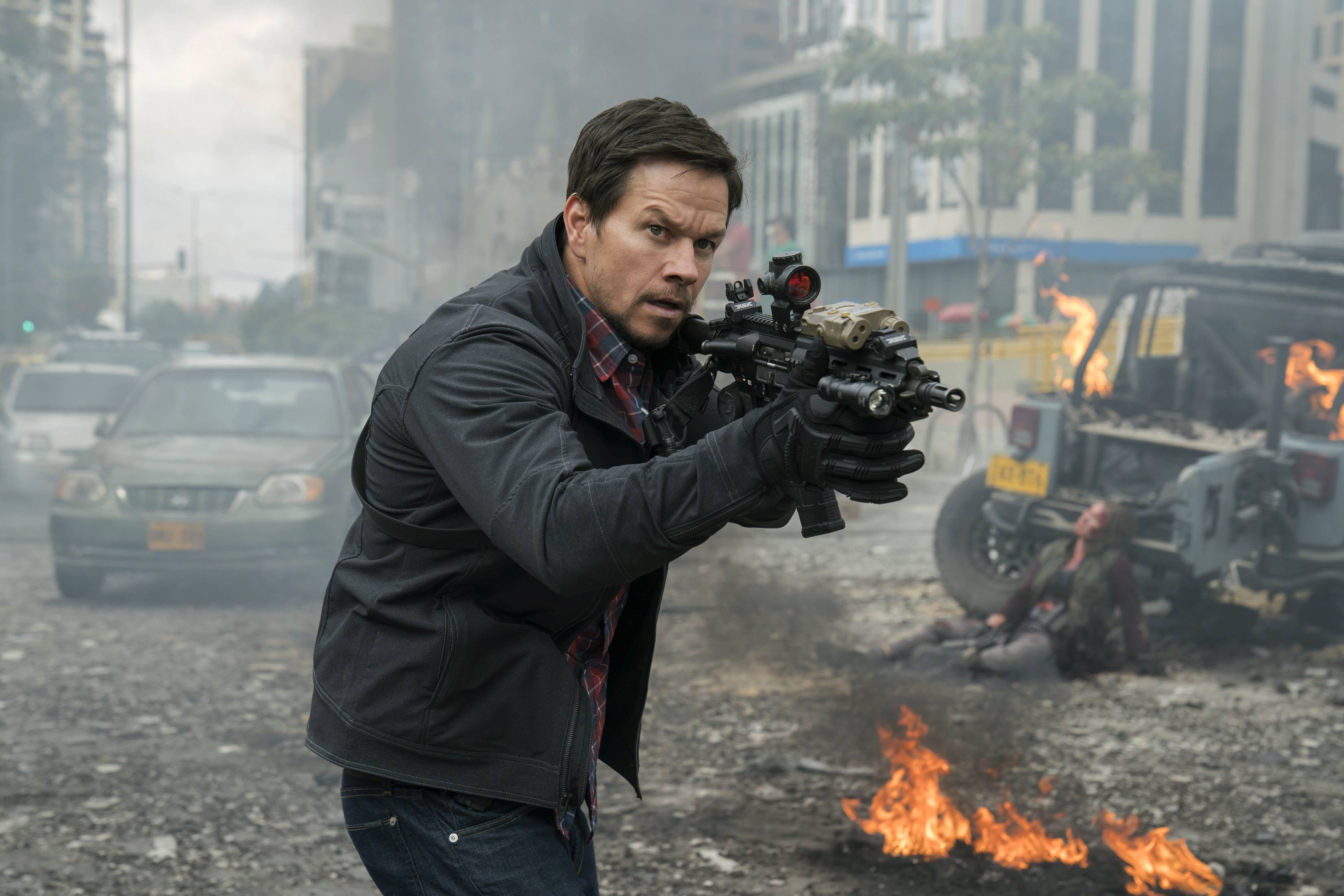 "An operative (Mark Wahlberg) takes on a dangerous mission in ""Mile 22."""