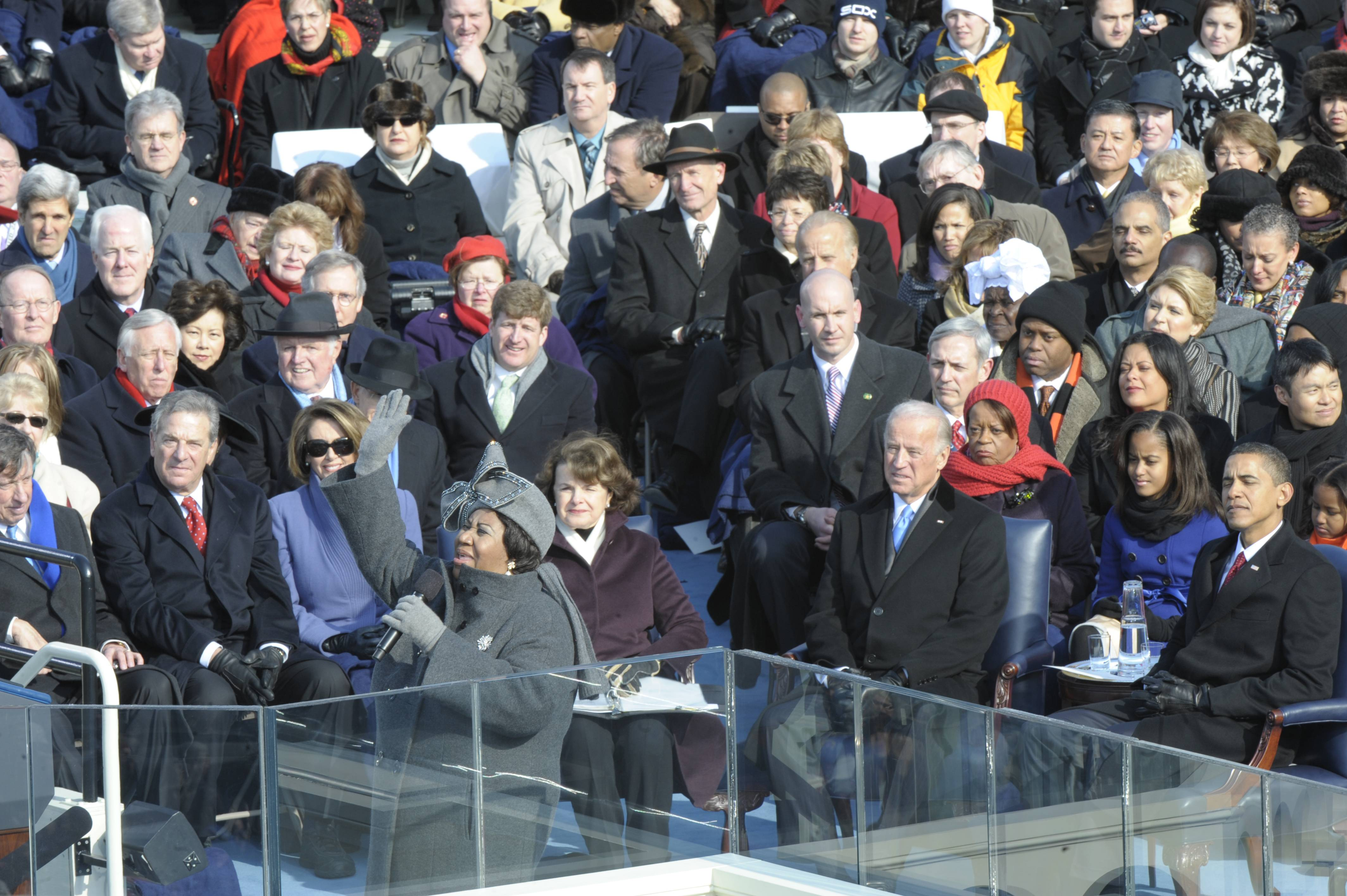 Aretha Franklin, front, in gray hat with hand raised, sings at Barack Obama's 2009 inauguration in Washington.