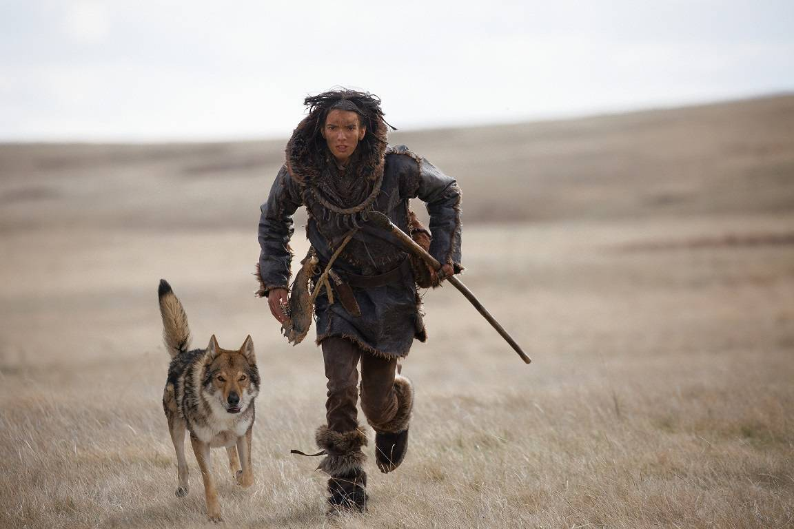 "Keda (Kodi Smit-McPhee) bonds with a wolf as he struggles to survive in ""Alpha."""