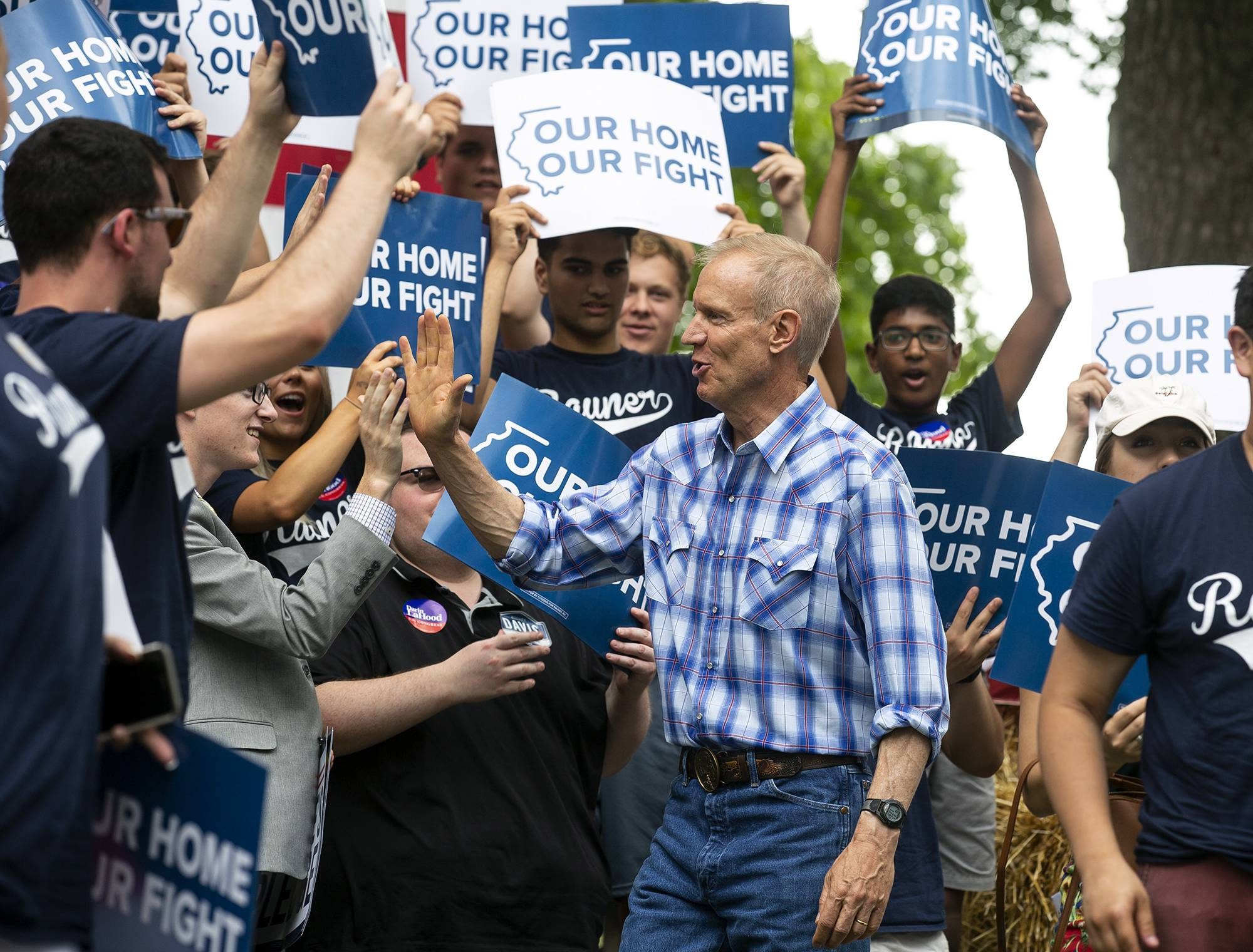 Gov. Bruce Rauner greets supporters Wednesday before he takes the stage at Governor's Day at the Illinois State Fair in Springfield.