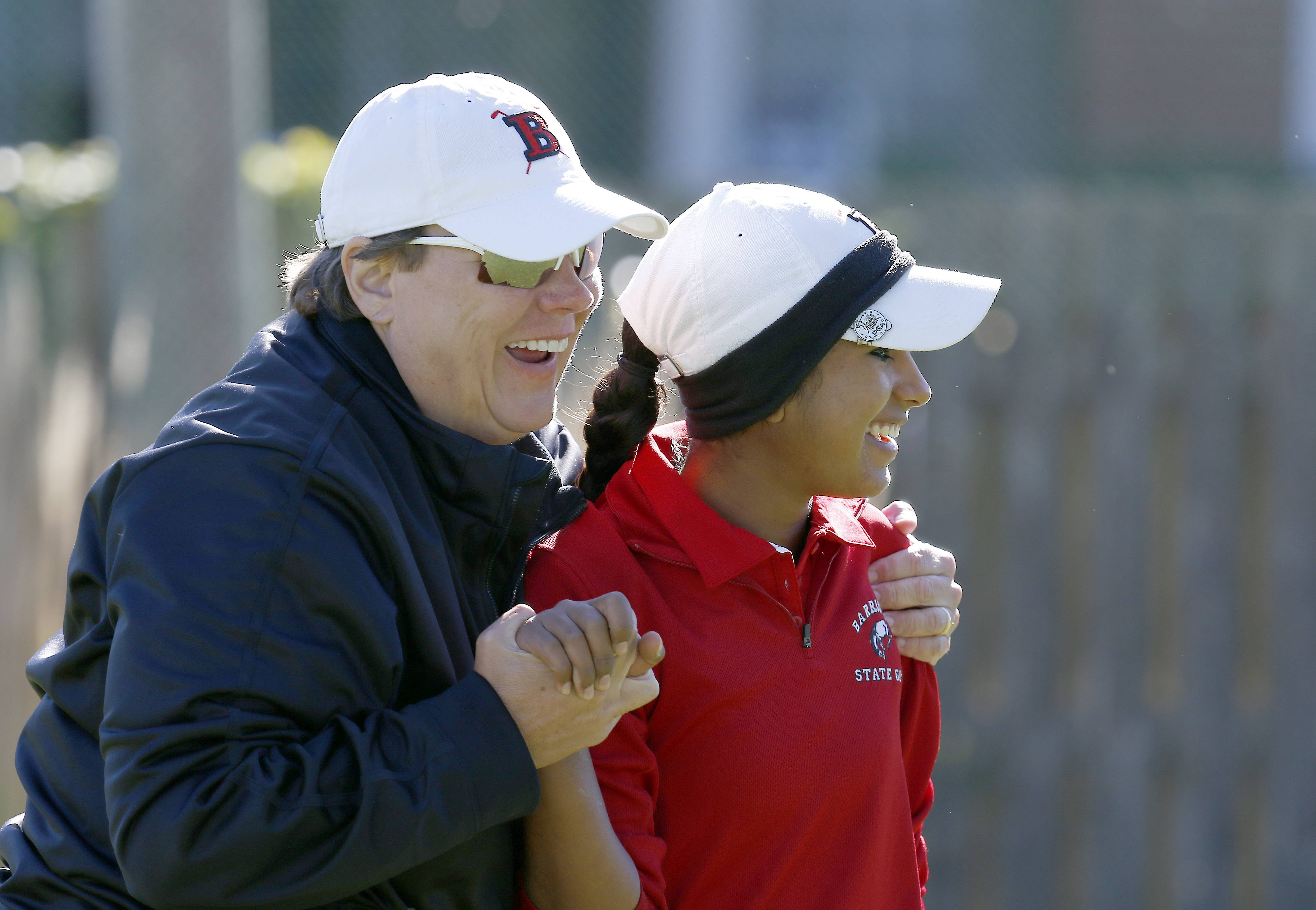 Barrington's Reena Sulkar is greeted by her coach Jodi Schoeck after a hole in one on the 14th hole during the Mid-Suburban League meet at Arlington Lakes in 2016. Schoeck will retire after this season, her 32nd in charge of the Fillies' girls golf program.