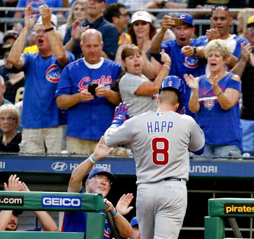Chicago Cubs' Ian Happ (8) is greeted by manager Joe Maddon, left, and cheering Cubs fans after hitting a solo home run against the Pittsburgh Pirates during the fourth inning of a baseball game Thursday, Aug. 16, 2018, in Pittsburgh.