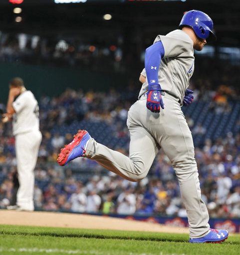 Chicago Cubs' Ian Happ rounds the bases after hitting a solo home run off Pittsburgh Pirates starting pitcher Ivan Nova, left, during the fourth inning of a baseball game Thursday, Aug. 16, 2018, in Pittsburgh.