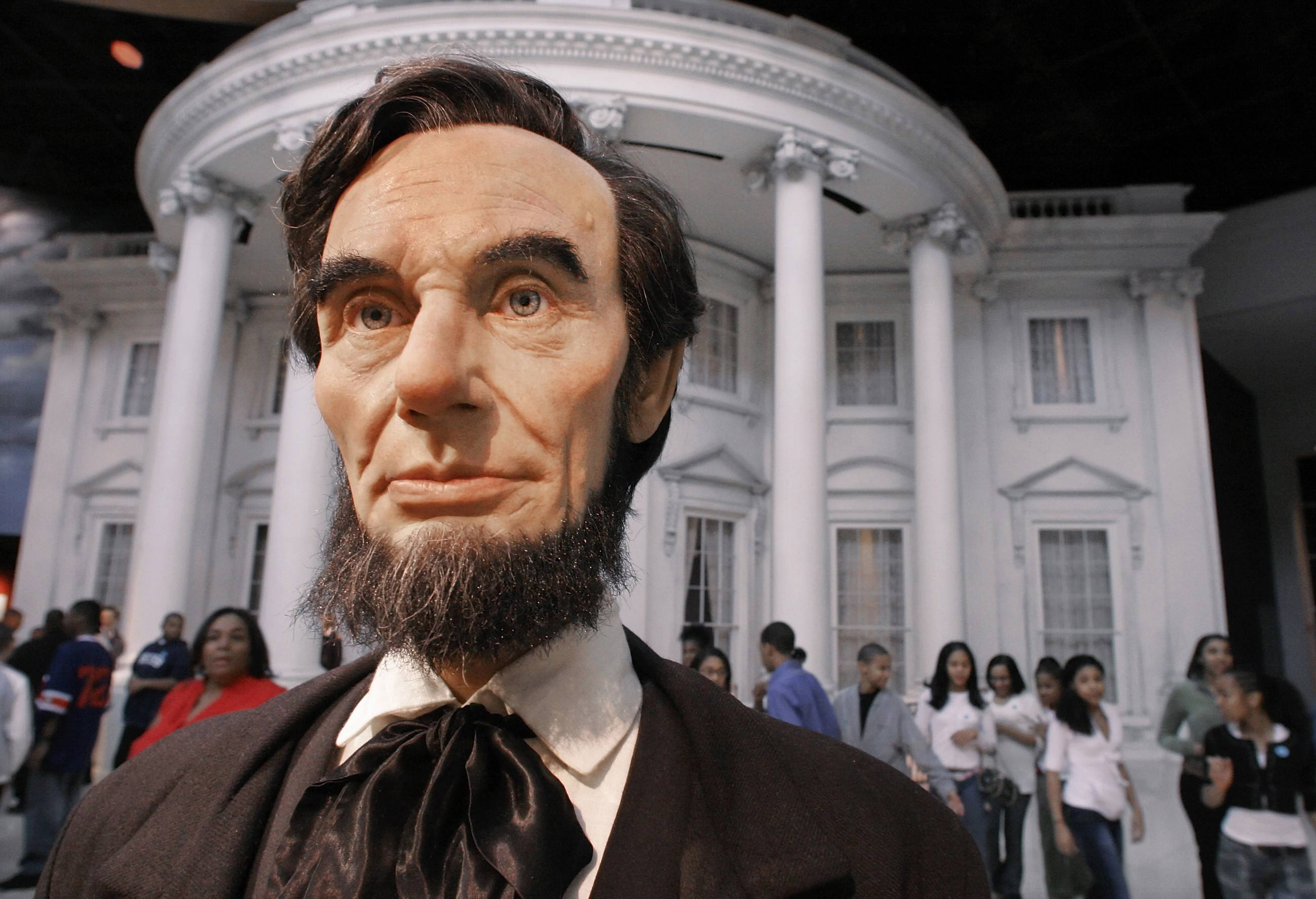 A replica of Abraham Lincoln, in 1861, and the White House, is seen by visitors as they enter the Abraham Lincoln Presidential Museum in Springfield, Ill., on the anniversary of Lincoln's birthday Monday, Feb. 12, 2007. (AP Photo/Seth Perlman)