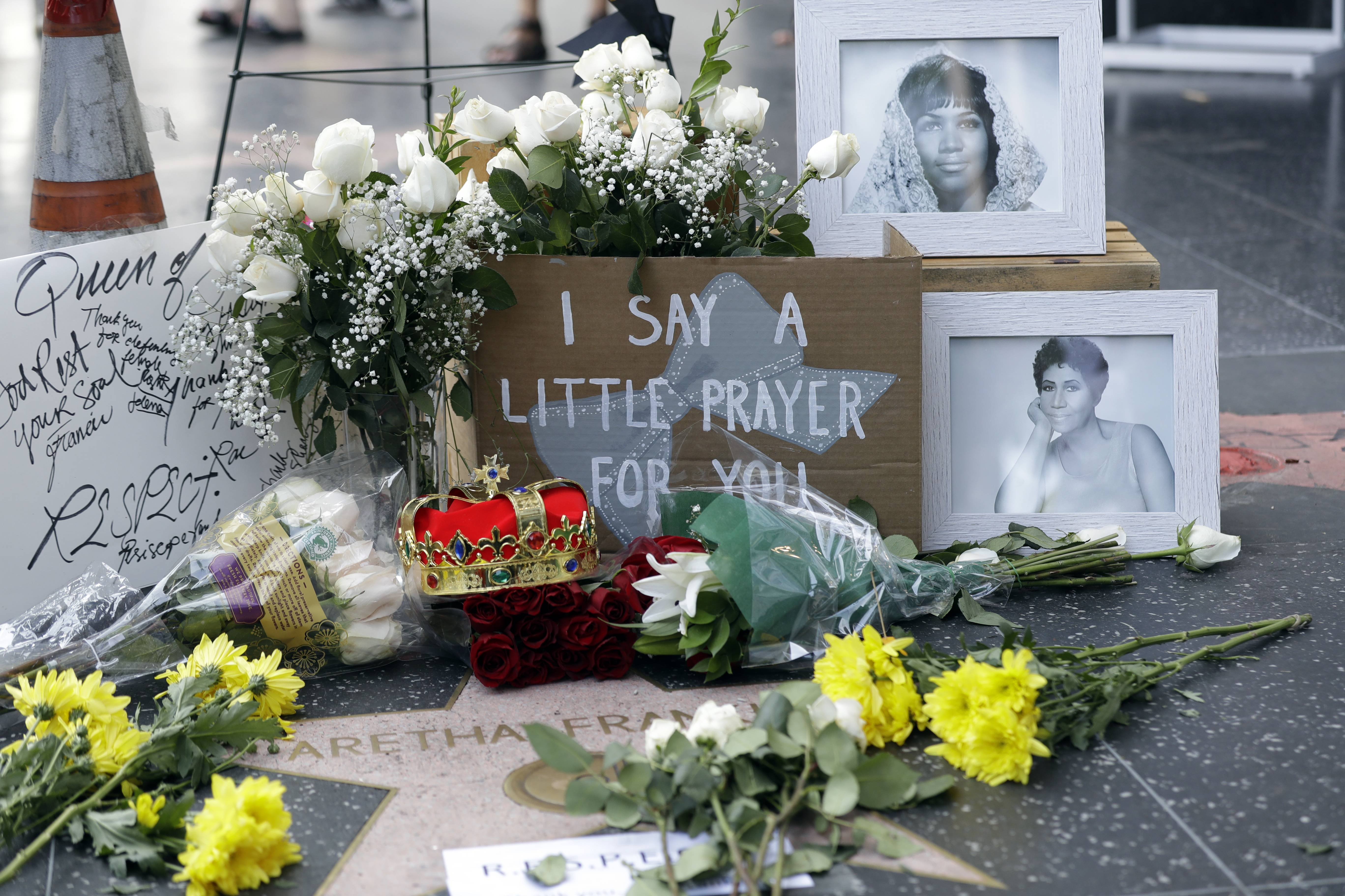 Flowers and signs are placed on Aretha Franklin's star at the Hollywood Walk of Fame Thursday, Aug. 16, 2018, in Los Angeles. Franklin died Thursday at 76. She was born and rose to fame during the segregation era and went on to sing at the inauguration of the first black president, often used her talent, fortune and platform to inspire millions of black Americans and support the fight for racial equality.