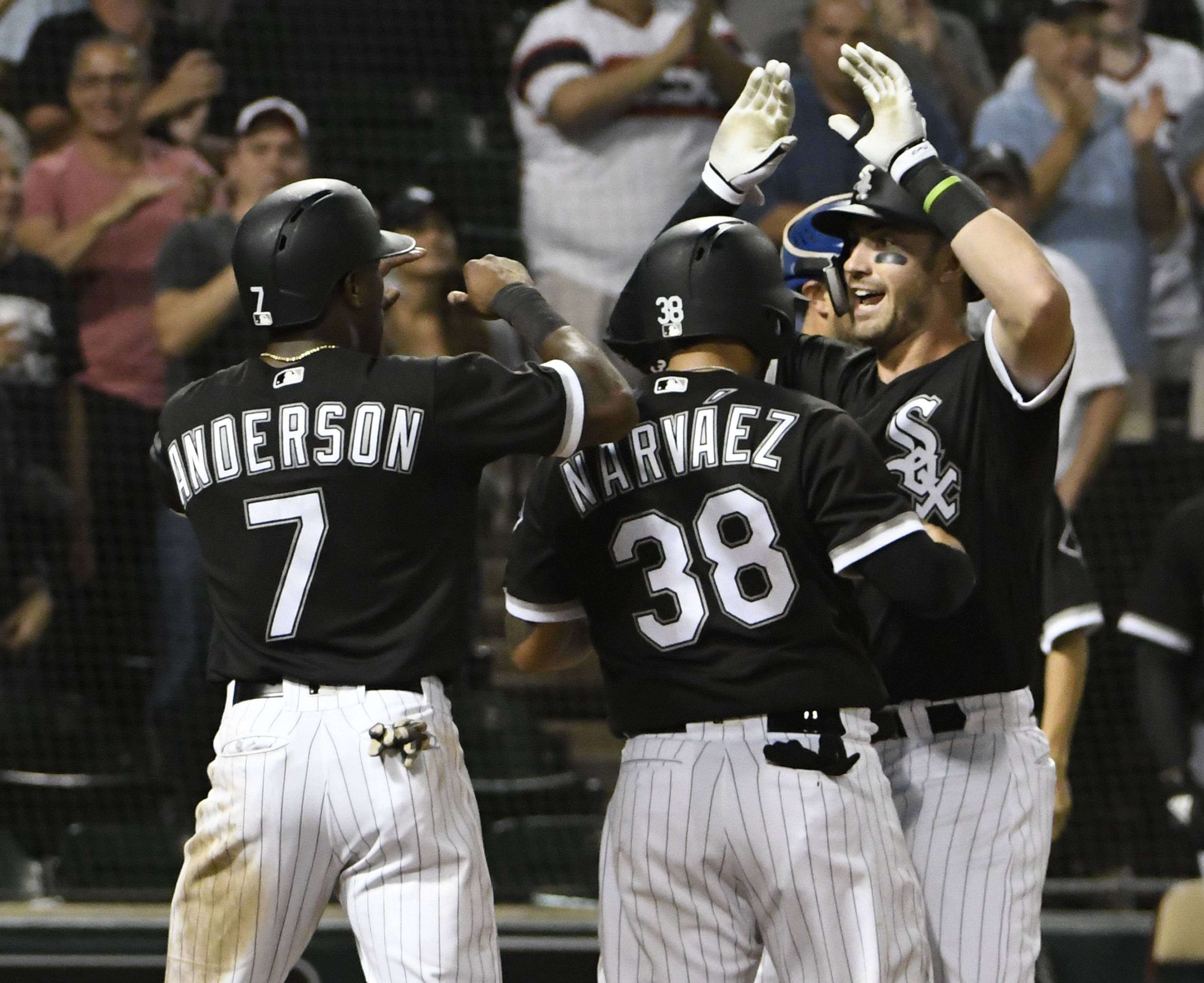 Chicago White Sox's Nicky Delmonico, right, is greeted by Omar Narvaez (38) and Tim Anderson (7) after hitting a three-run home run against the Kansas City Royals during the seventh inning of a baseball game Friday, Aug. 17, 2018, in Chicago. (AP Photo/David Banks)