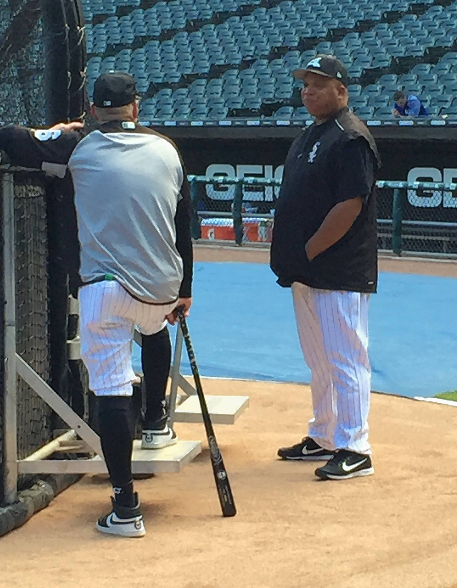 Chicago White Sox hitting coach Todd Steverson, right, talks with assistant hitting coach Greg Sparks before Friday night's game against the Kansas City Royals at Guaranteed Rate Field.