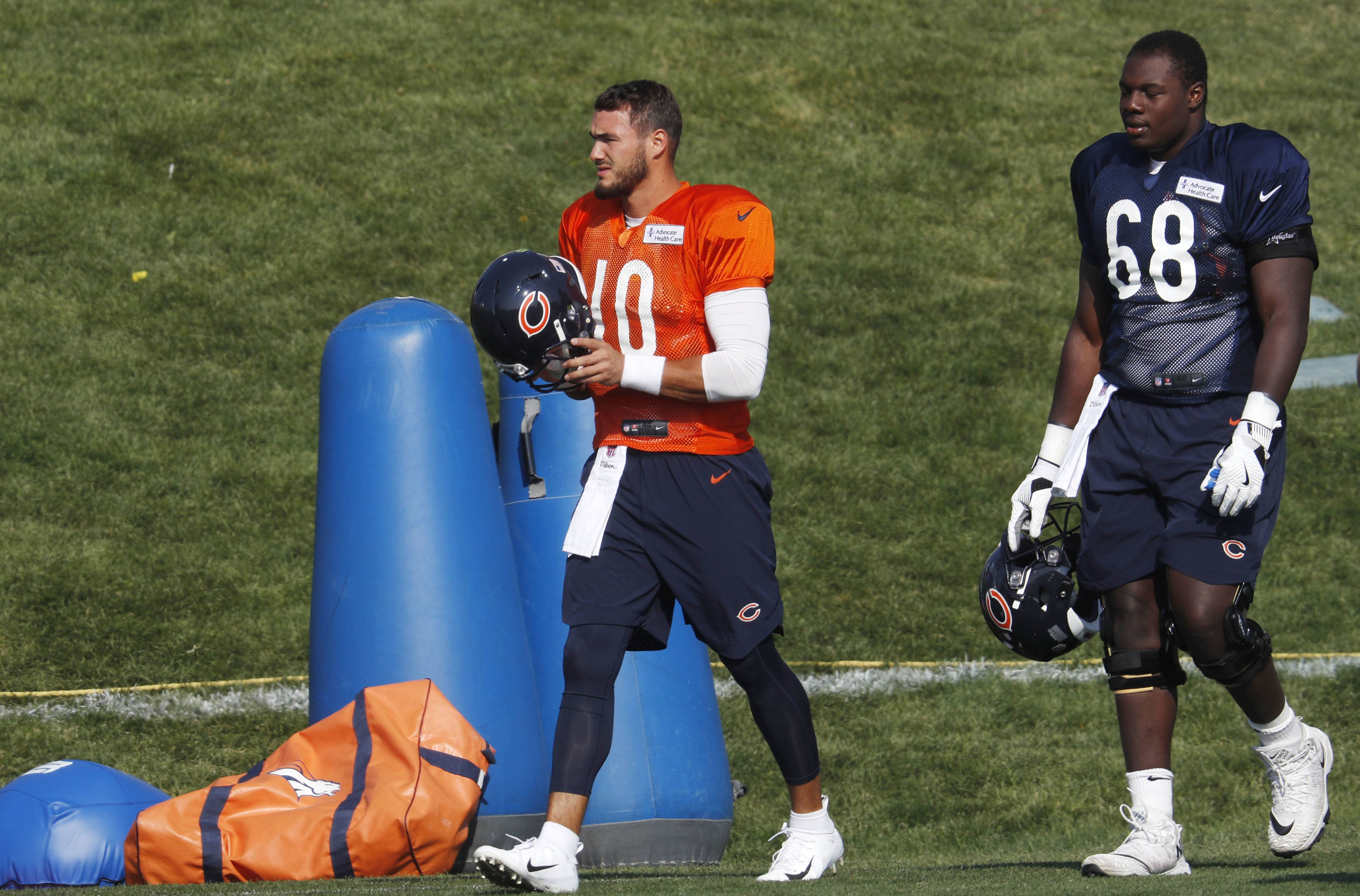 Chicago Bears quarterback Mitchell Trubisky, left, and center James Daniels head to drills during a joint NFL football training camp session with the Denver Broncos, Thursday, Aug. 16, 2018, in Englewood, Colo.