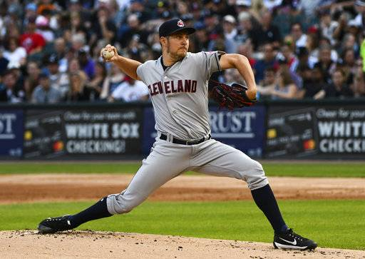 FILE - In this Aug. 11, 2018, file photo, Cleveland Indians starting pitcher Trevor Bauer delivers against the Chicago White Sox during the first inning of a baseball game in Chicago. Bauer, one of the leading candidates for the AL Cy Young Award, will be out four to six weeks because of a stress fracture in his right leg. (AP Photo/Matt Marton, File)