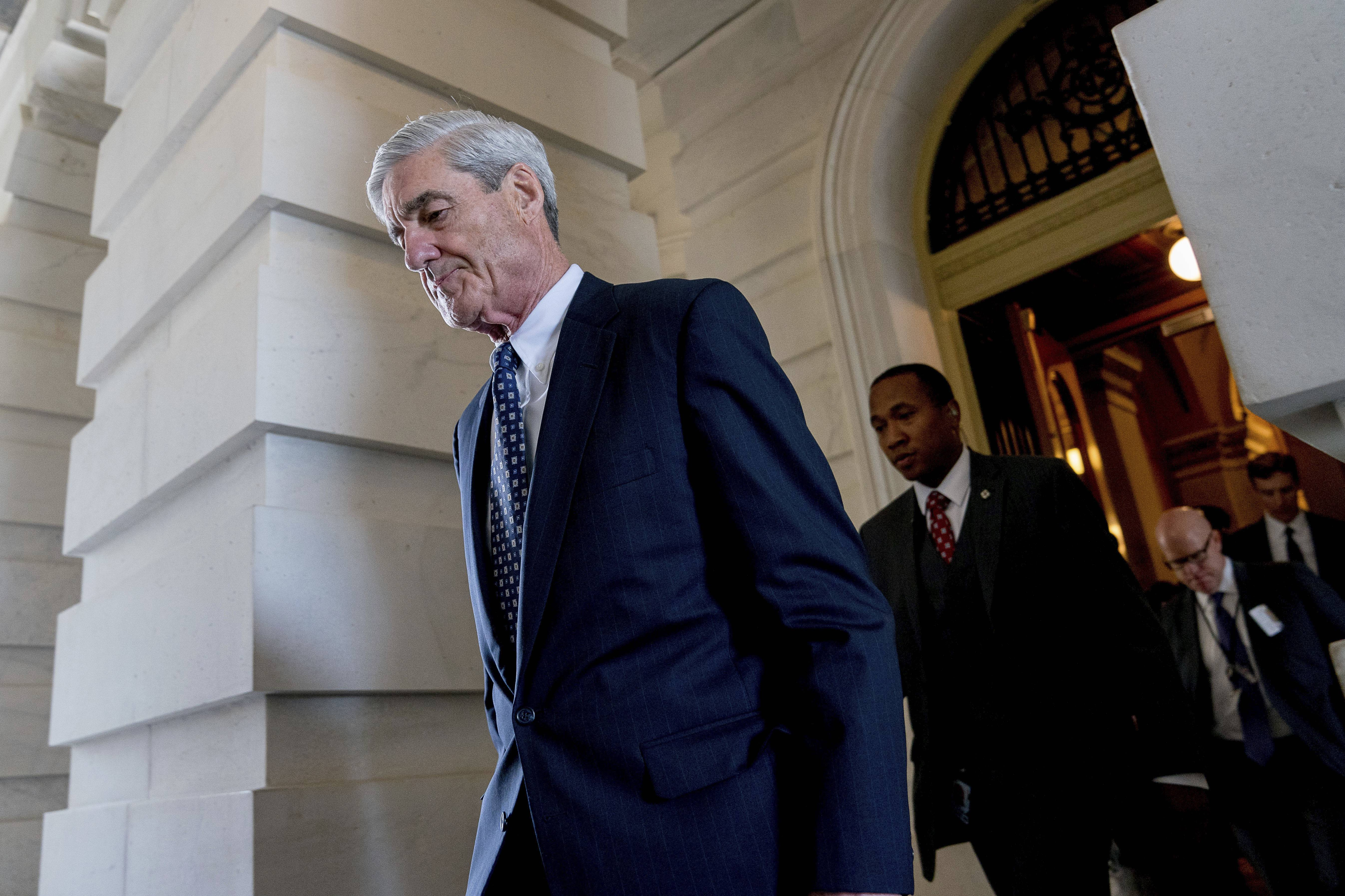 FILE - In this June 21, 2017, file photo, former FBI Director Robert Mueller, the special counsel probing Russian interference in the 2016 election, departs Capitol Hill following a closed door meeting in Washington. Prosecutors working for Mueller are recommending a short prison sentence for a former Trump campaign adviser who lied to the FBI during the Russia probe. Mueller's team says in a new court filing that George Papadopoulos should spend at least some time incarcerated and pay a nearly $10,000 fine. His recommended sentence under federal guidelines is zero to six months, but prosecutors note a similar defendant in the case spent 30 days in jail.(AP Photo/Andrew Harnik, File)