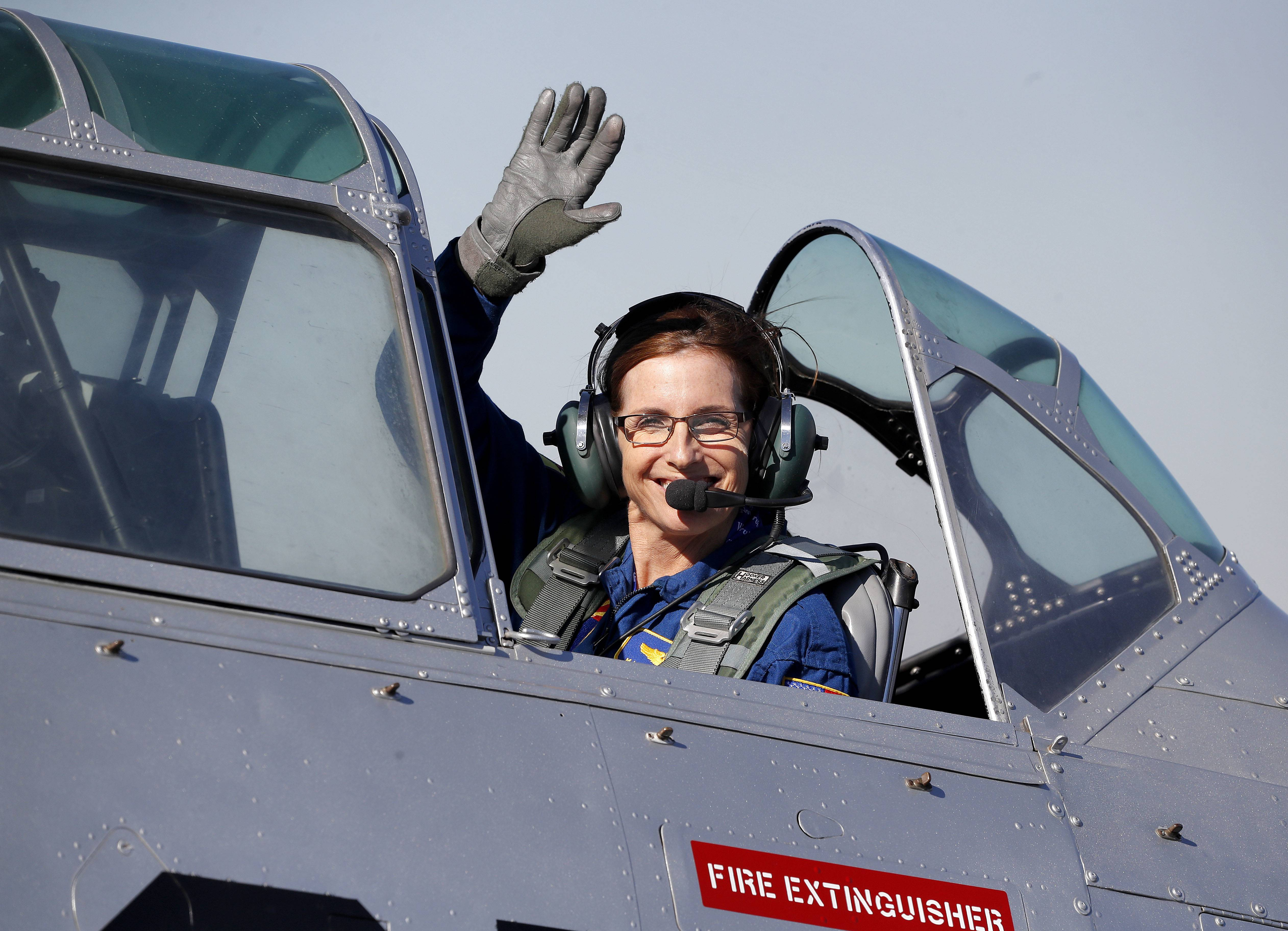 Rep. Martha McSally, an Arizona Republican, leaves in a T-6 World War II airplane after speaking at a rally in Phoenix. Women with military experience — many of them combat veterans — are among the record number of female candidates running for office this year.