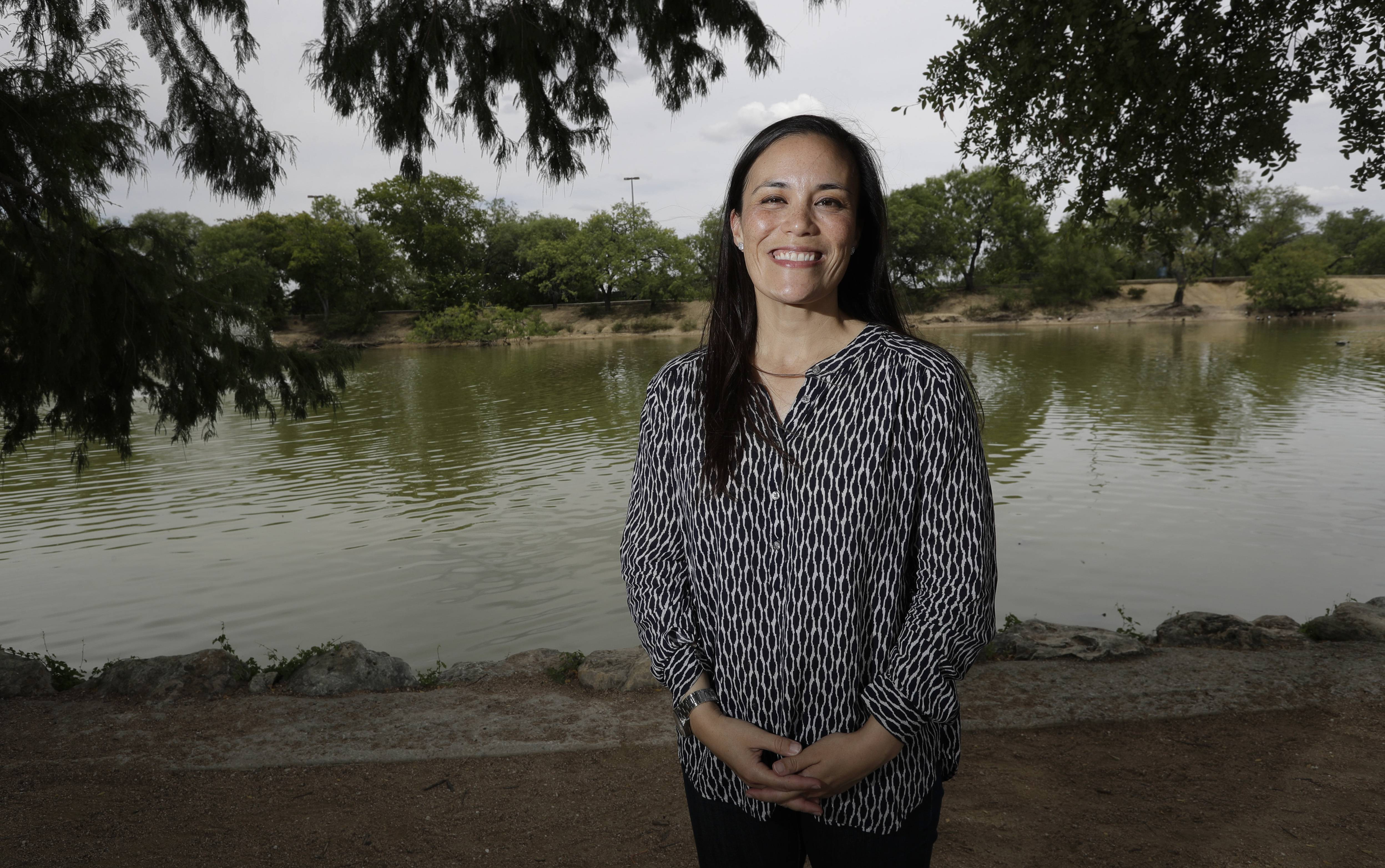 Gina Ortiz Jones, the Democratic nominee for a House seat in West Texas, poses for a photo, Friday, Aug. 10, 2018, in San Antonio, Texas. Jones, an Air Force veteran will face Republican Rep. Will Hurd. Currently, only four of 535 lawmakers are both women and veterans. Women with military experience  many of them combat veterans  are among the record number of female candidates running for office this year.