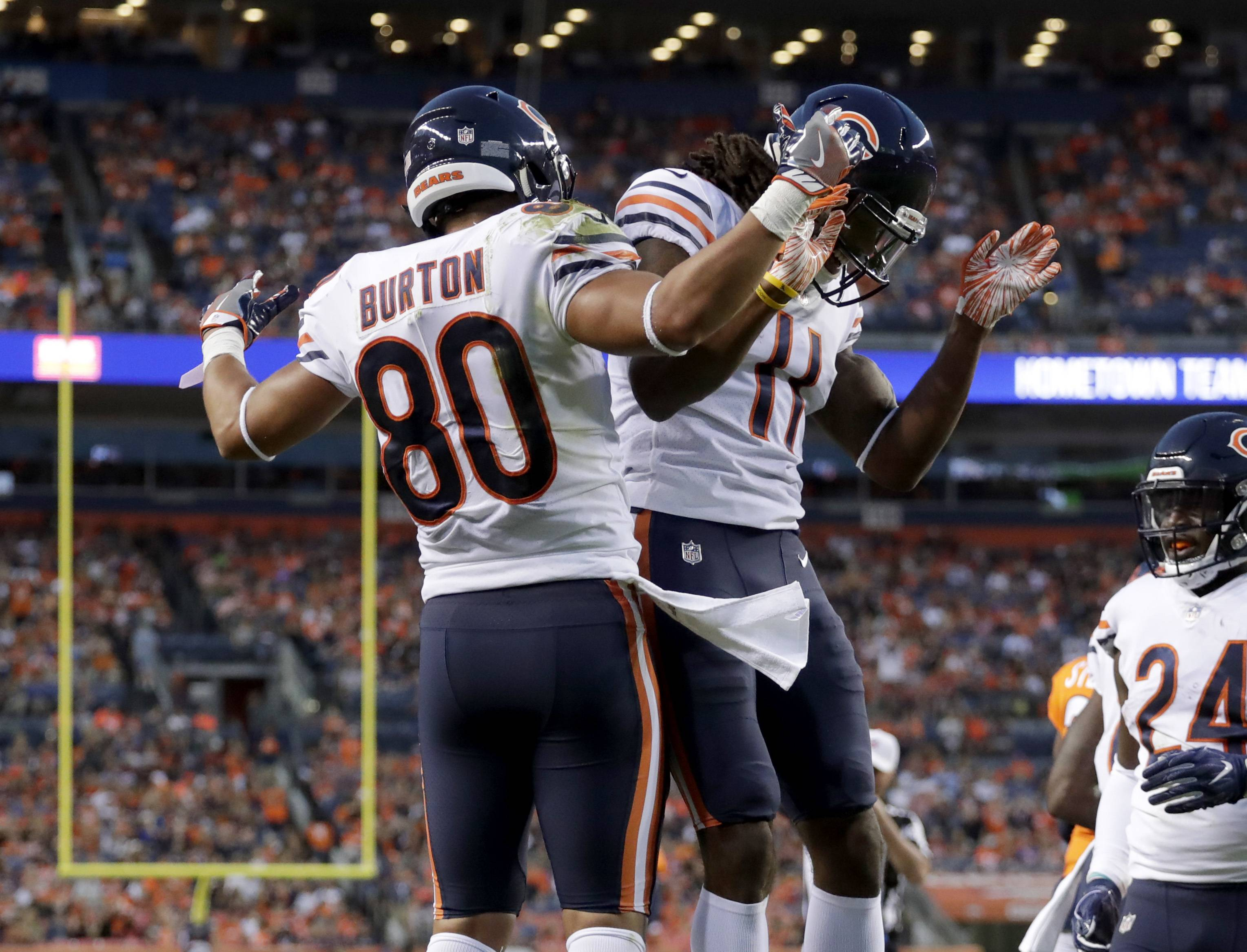 Chicago Bears tight end Trey Burton (80) celebrates his touchdown with wide receiver Kevin White (11) during the first half of a preseason NFL football game against the Denver Broncos, Saturday, Aug. 18, 2018, in Denver. (AP Photo/Jack Dempsey)