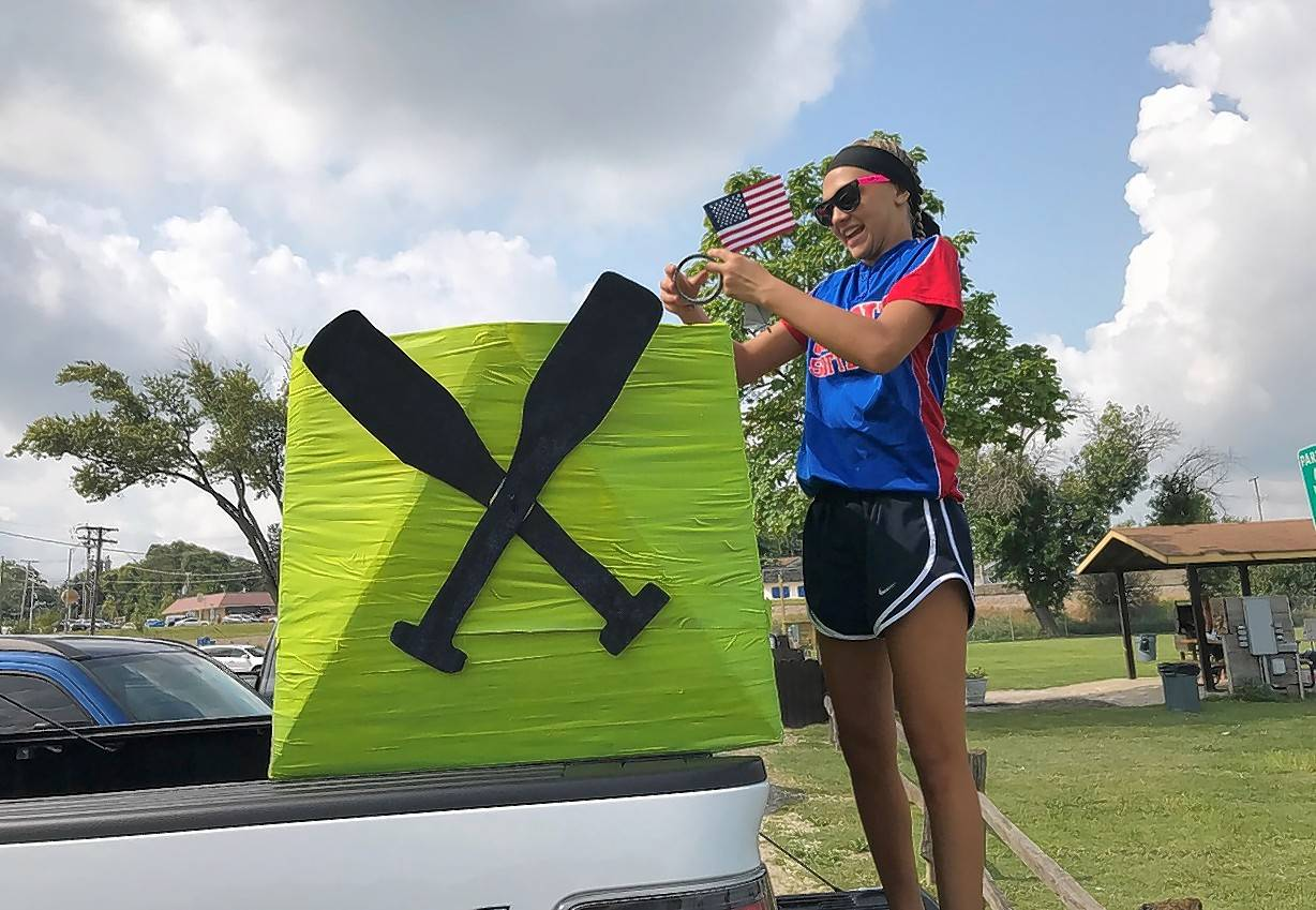 Jennie Woodruff, 13, of Spring Grove, puts the finishing touches on a softball-themed boat Sunday before the 21st annual Cardboard Boat Race in Fox Lake.