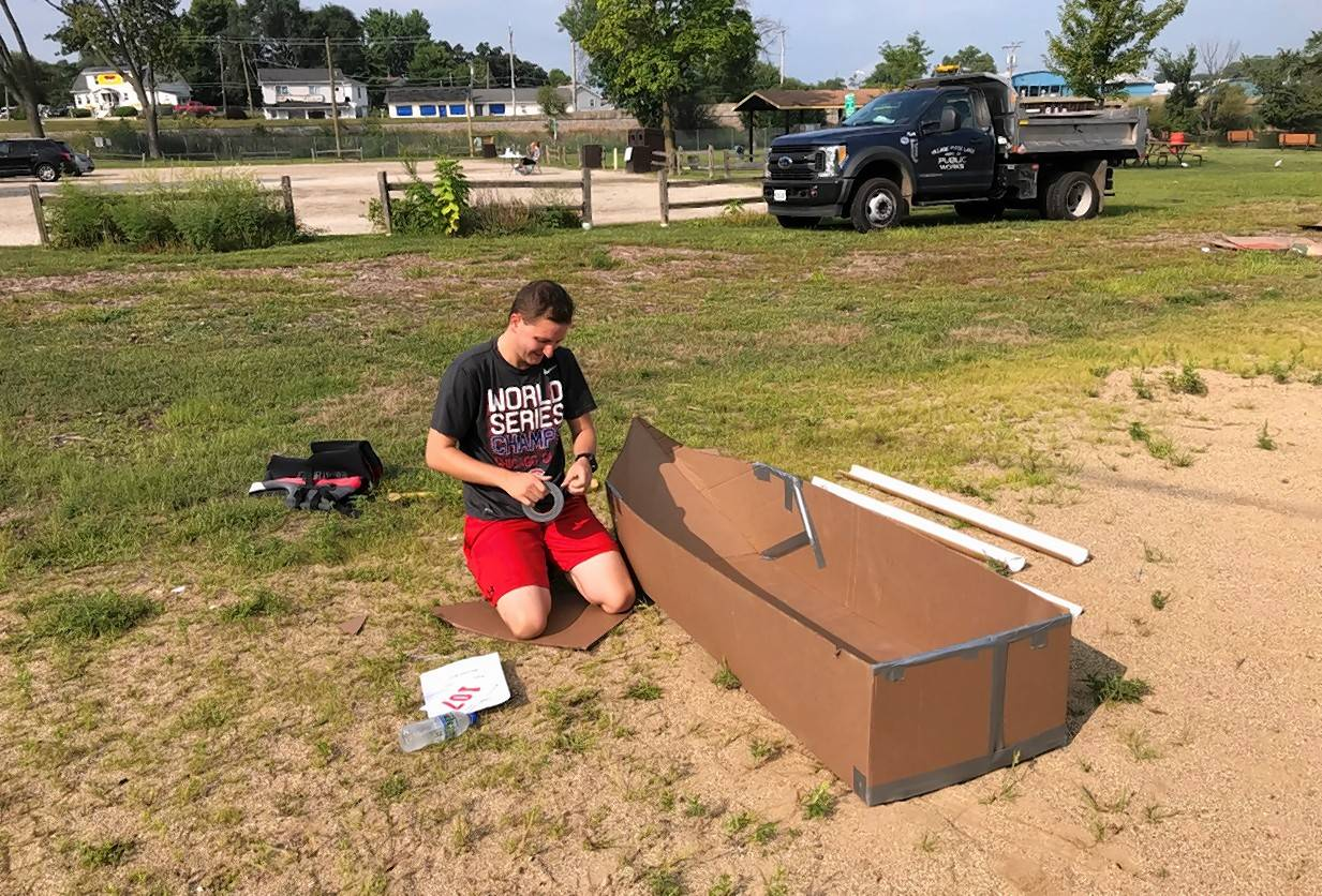 Nick Frillman of Schaumburg spends Sunday morning meticulously building his boat to compete in the 21st annual Cardboard Boat Race at Lakefront Park in Fox Lake.