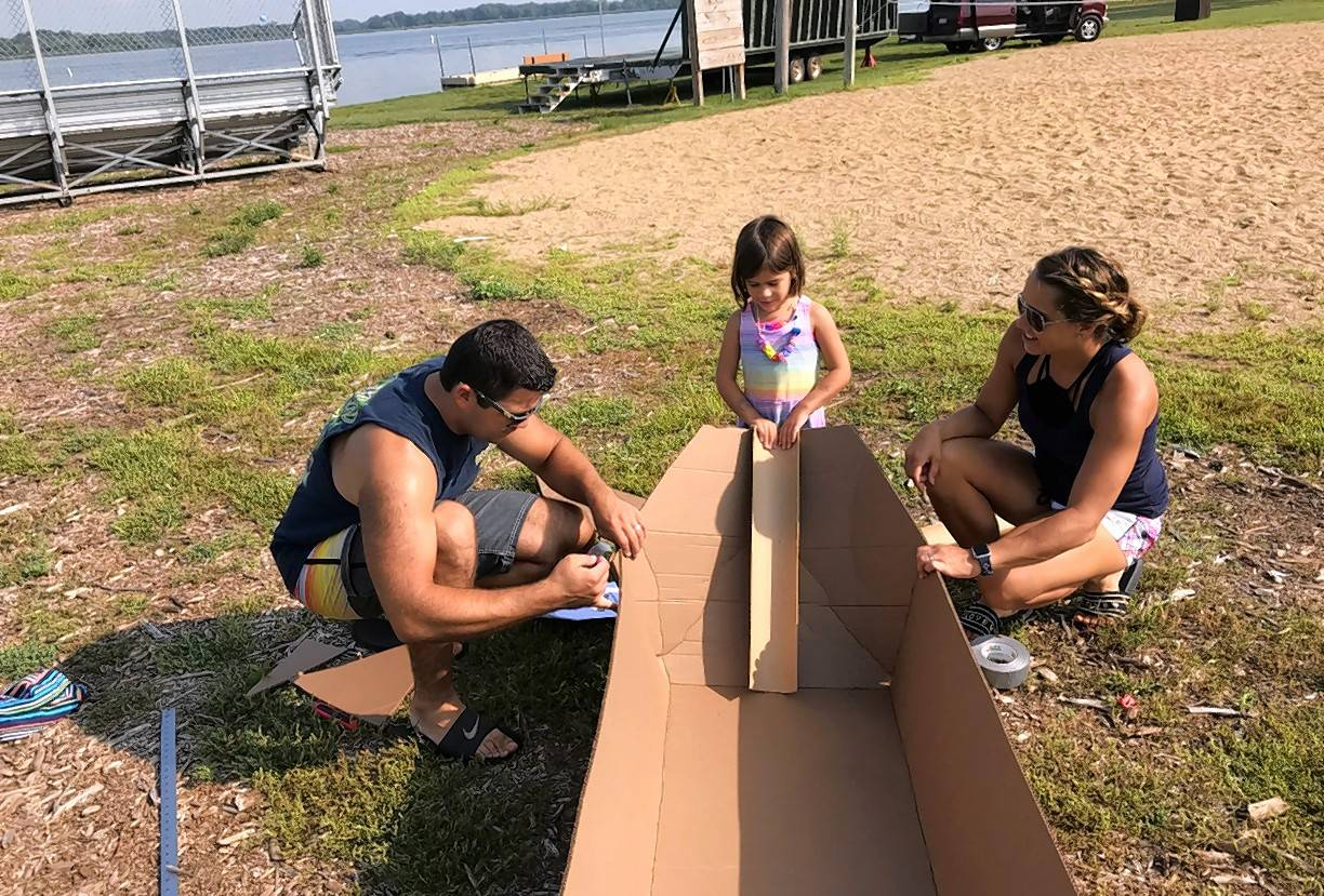 Genoa City, Wisconsin resident Josh Himmelspach, his wife Kelly and their daughter Jocelyn, 4, get ready for Sunday's 21st annual Cardboard Boat Race at Lakefront Park in Fox Lake.