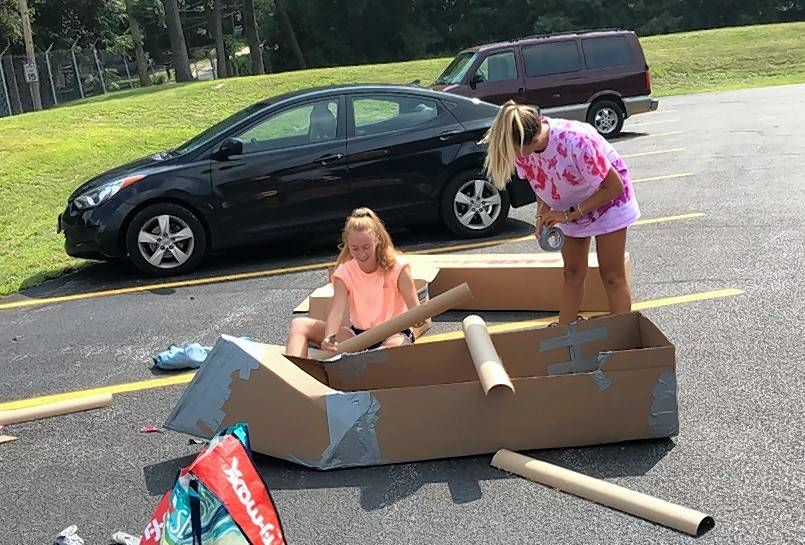 Bre Retherford and Gabby Ross of Spring Grove built their first entry for the 21st annual Cardboard Boat Race at Lakefront Park in Fox Lake.