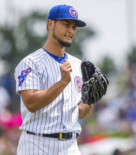 Chicago Cubs' Yu Darvish reacts after a pitch during the Great Lakes Loons at South Bend Cubs baseball game Sunday, Aug. 19, 2018, at Four Winds Field in South Bend, Ind. Darvish was on rehab assignment with the Class A affiliate of the major league team. (Robert Franklin/South Bend Tribune via AP)