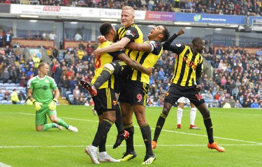 Watford's Will Hughes, centre, celebrates scoring his side's third goal of the game against Burnley, during their English Premier League soccer match at Turf Moor in Burnley, England, Sunday Aug. 19, 2018. (Dave Howarth/PA via AP)