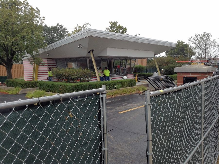 Workers were making site preparations Monday at the site of Ray Kroc's original McDonald's in Des Plaines, where a 32-year-old replica building is scheduled for demolition as soon as Tuesday.