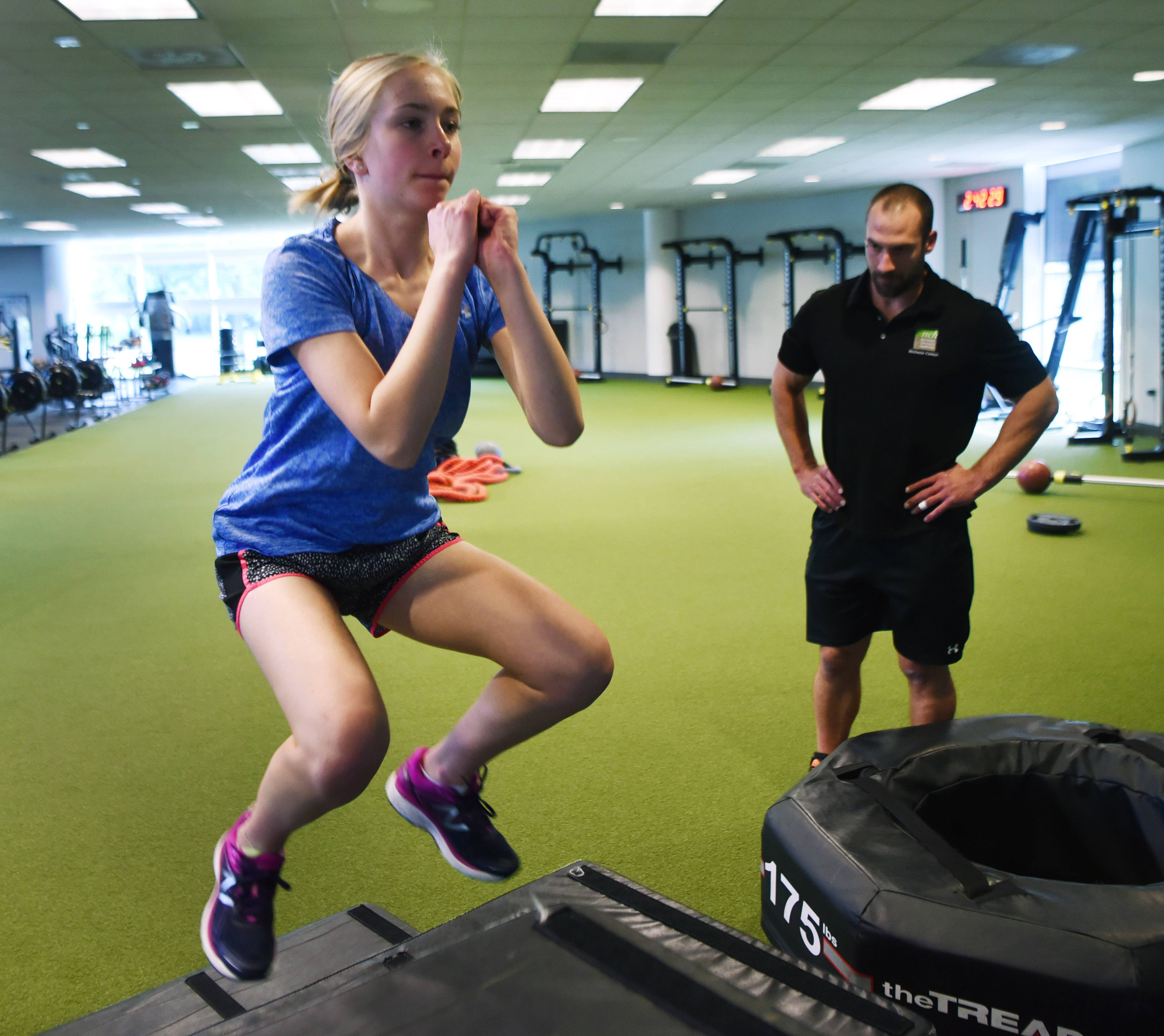 KC Jones, a Rolling Meadows High School sophomore from Arlington Heights, works out under the direction of personal trainer Matt Brauer at the Northwest Community Hospital Wellness Center.