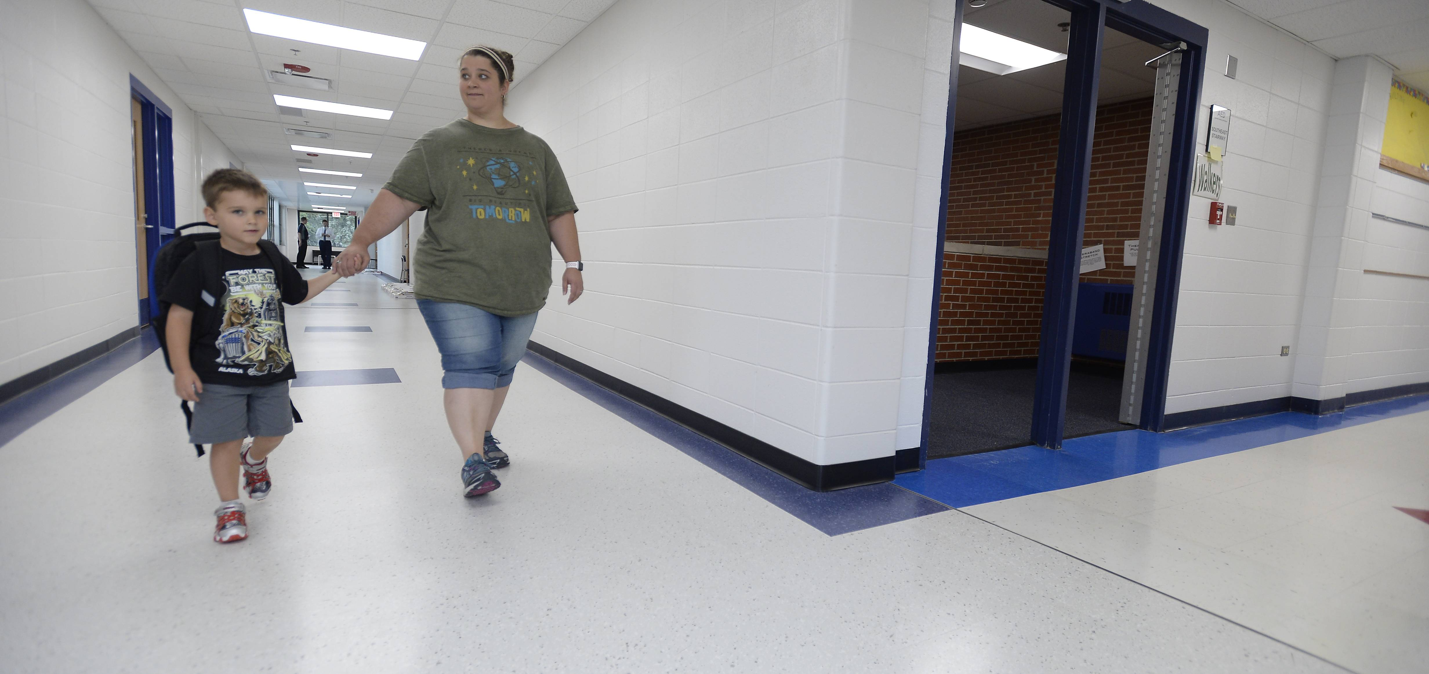Amanda Loch and her son Evan, 4, explore the 8,280-square-foot addition of Greenbrier Elementary School in Arlington Heights, where the old building to the right intersects with the new on the left.