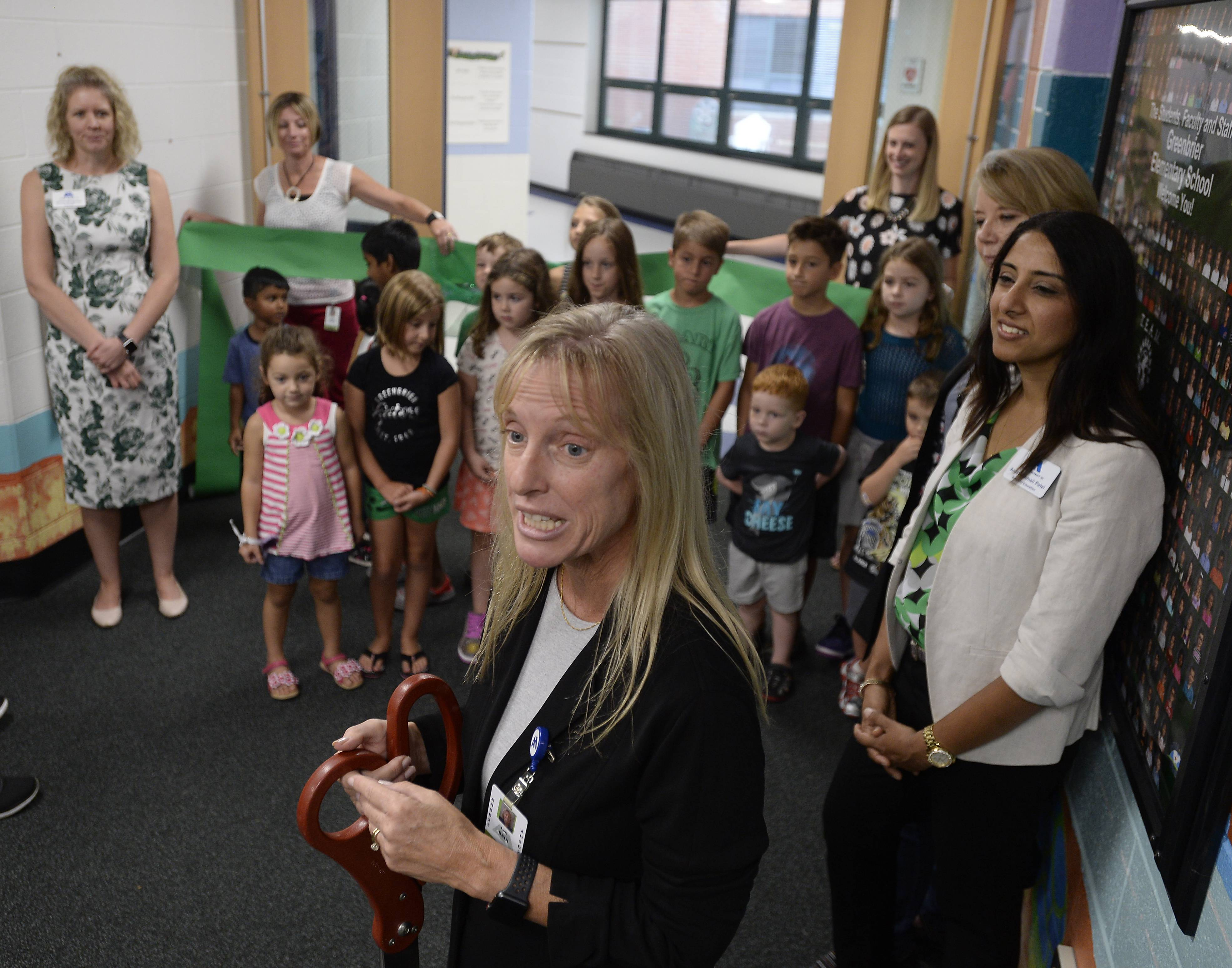 Arlington Heights Elementary District 25 Superintendent Lori Bein prepares to cut the ribbon Monday with school board members, Greenbrier Elementary staff and students on a new 8,280-square-foot building addition.
