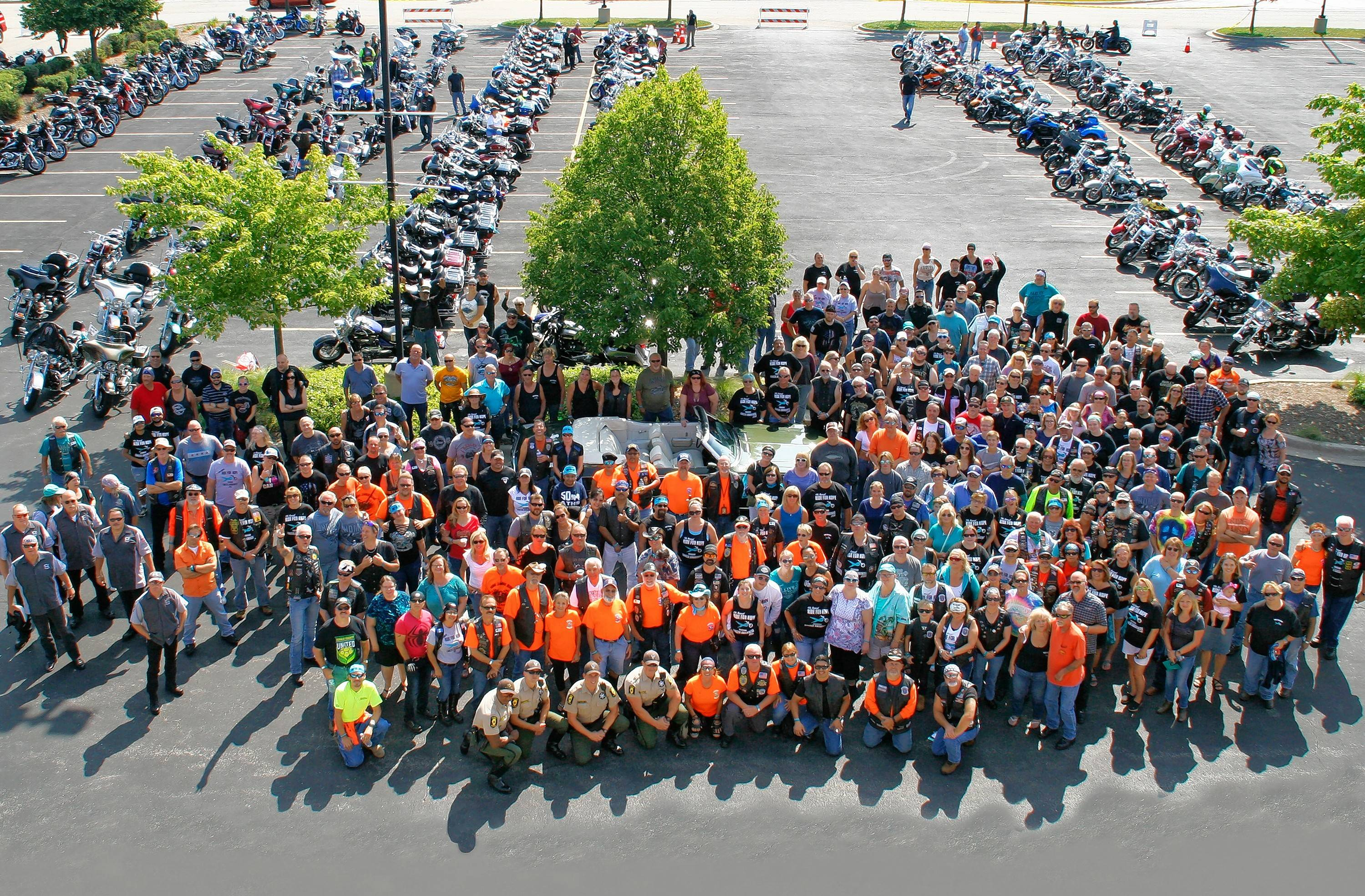 Two hundred and seventy Ride for Hope bikers gather for a group photo July 29 at the Fox River Harley-Davidson dealership in St. Charles before the ride.