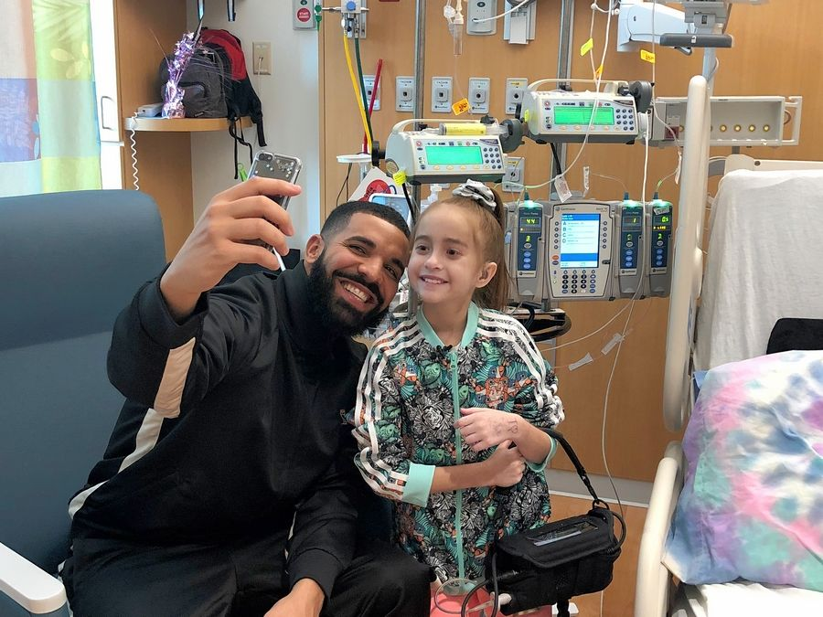 Drake takes a selfie Monday with 11-year-old Sofia Sanchez, a Downers Grove girl who is a heart patient at Lurie Children's Hospital in Chicago.