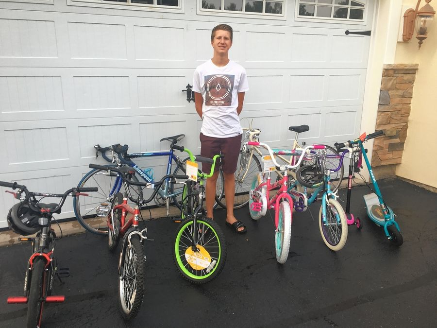 Jacobs High School senior Justin Lorenz, 17, is collecting gently used bikes for kids and teens who visit the Boys and Girls Clubs of Dundee Township.