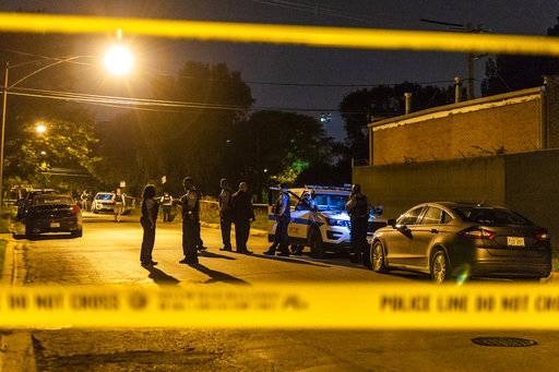 Chicago Police investigate a person shot Sunday, Aug. 19, 2018, in Chicago. (Tyler LaRiviere/Chicago Sun-Times via AP)