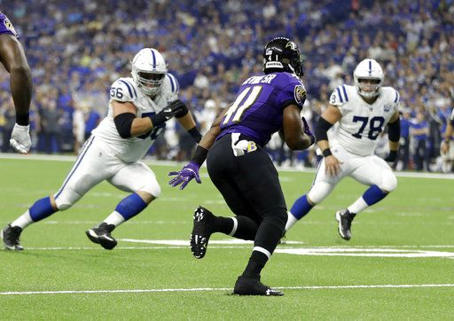 Baltimore Ravens defensive back Anthony Levine (41) returns an interception between Indianapolis Colts offensive guard Quenton Nelson (56) and center Ryan Kelly (78) in the first half of an NFL preseason football game in Indianapolis, Monday, Aug. 20, 2018.