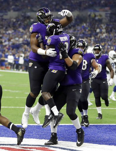 Baltimore Ravens wide receiver John Brown (13) celebrates a touchdown catch with teammates against the Indianapolis Colts in the first half of an NFL preseason football game in Indianapolis, Monday, Aug. 20, 2018.
