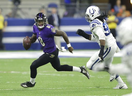 Baltimore Ravens quarterback Lamar Jackson (8) scrambles away form Indianapolis Colts defensive end Denico Autry (95) in the first half of an NFL preseason football game in Indianapolis, Monday, Aug. 20, 2018.
