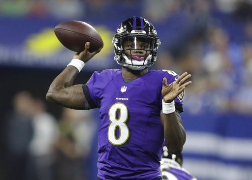Baltimore Ravens quarterback Lamar Jackson (8) throws against the Indianapolis Colts in the first half of an NFL preseason football game in Indianapolis, Monday, Aug. 20, 2018.