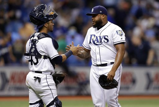 Tampa Bay Rays pitcher Jose Alvarado, right, celebrates with catcher Michael Perez after closing out the Kansas City Royals during a baseball game Monday, Aug. 20, 2018, in St. Petersburg, Fla.