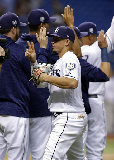 Tampa Bay Rays' Willy Adames celebrates with teammates after the Rays defeated the Kansas City Royals 1-0 during a baseball game Monday, Aug. 20, 2018, in St. Petersburg, Fla.