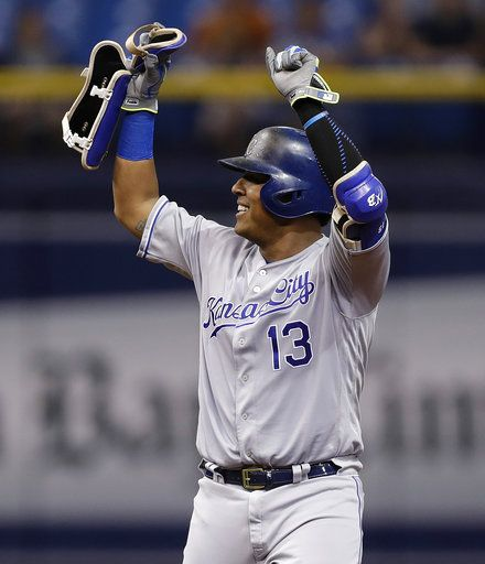 Kansas City Royals' Salvador Perez (13) celebrates after his double off Tampa Bay Rays pitcher Ryan Yarbrough during the third inning of a baseball game Monday, Aug. 20, 2018, in St. Petersburg, Fla.