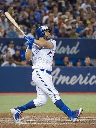 Toronto Blue Jays designated hitter Kendrys Morales (8) watches as he hits a three run home run against the Baltimore Orioles during fifth inning baseball action in Toronto on Monday, Aug. 20, 2018. (Nathan Denette/The Canadian Press via AP)