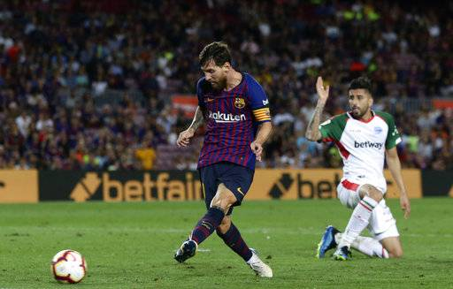 FC Barcelona's Lionel Messi kicks the ball to score against Alaves during a Spanish La Liga soccer match at Camp Nou stadium in Barcelona, Spain, Saturday, Aug. 18, 2018. (AP Photo/Manu Fernandez)