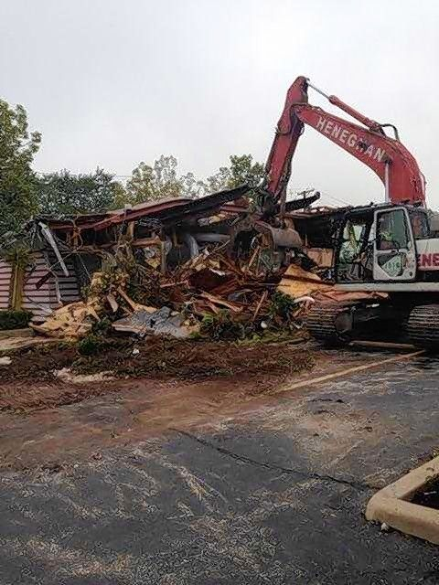 Demolition crews work Tuesday to take apart the 33-year-old replica McDonald's restaurant at 400 Lee St. in Des Plaines.