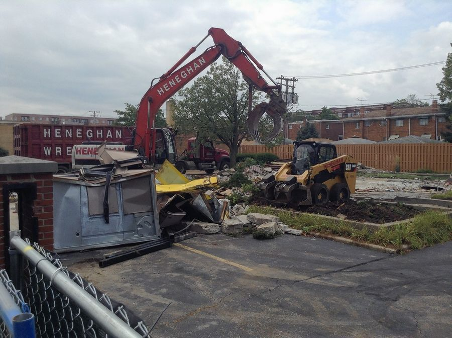 Demolition crews remained at the site of Ray Kroc's original McDonald's in Des Plaines Tuesday afternoon to clean up debris from the earlier teardown of a 33-year-old replica restaurant building.