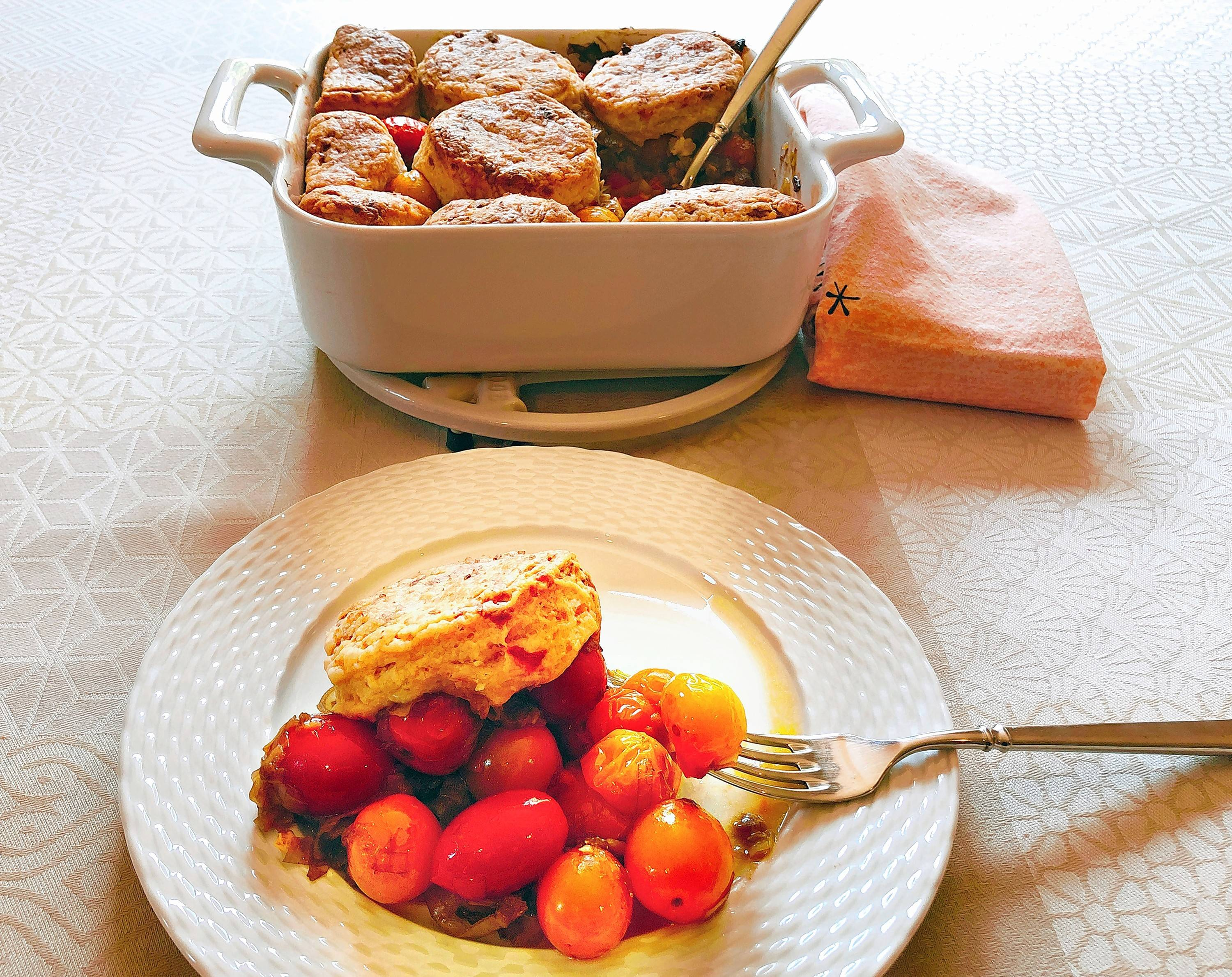 Cherry tomato cobbler with pimento cheese biscuits is a savory spin on a summery dessert. It's a simple showcase for all the cherry tomatoes ripening on the vine, too.