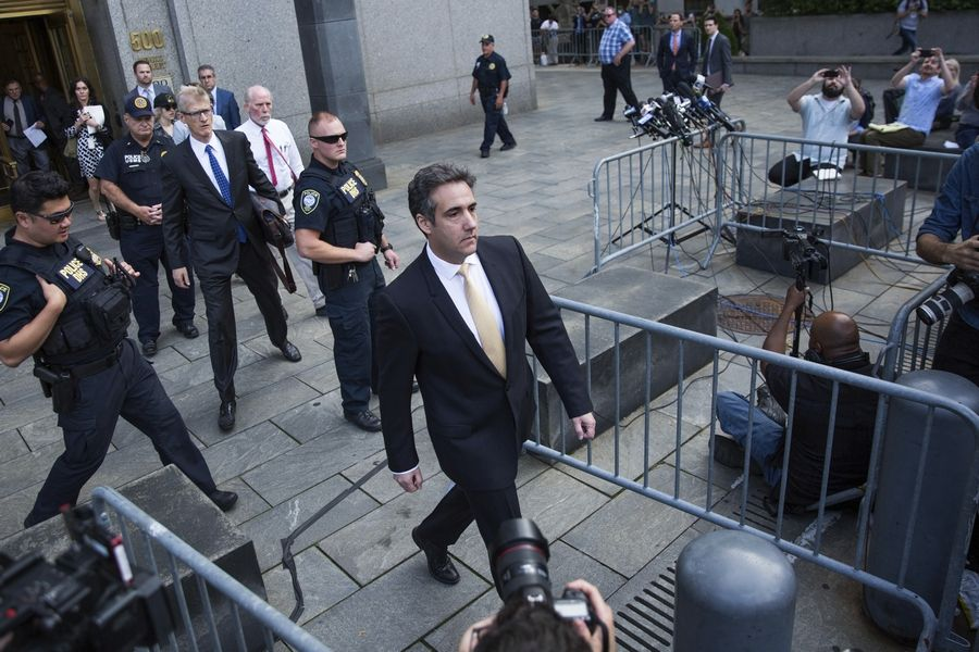 Michael Cohen, former lawyer to President Donald Trump, leaves court in New York on Tuesday after pleadin guilty to charges including campaign finance fraud stemming from hush money payments to porn actress Stormy Daniels and ex-Playboy model Karen McDougal.