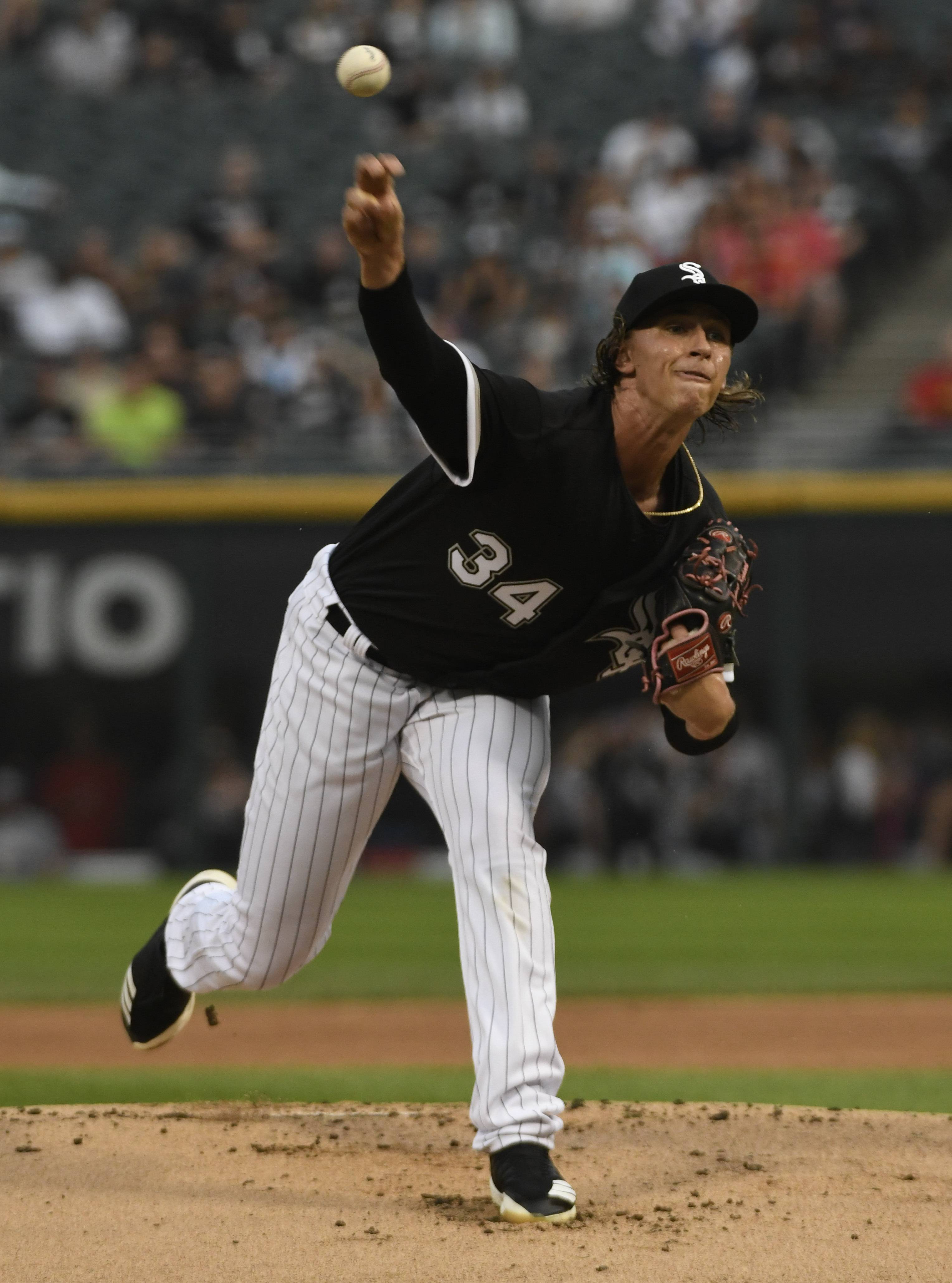 Chicago White Sox starting pitcher Michael Kopech (34) throws the ball against the Minnesota Twins during the first inning of a baseball game, Tuesday, Aug. 21, 2018, in Chicago. (AP Photo/David Banks)